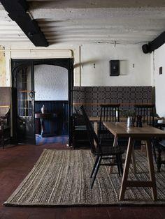 dining-rooms-dark-wood-exposed-beams-restaurants-rugs