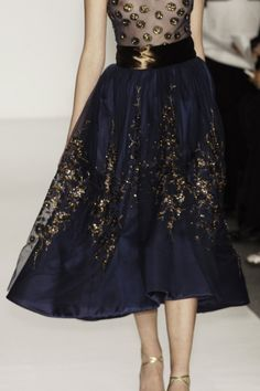 This would be the perfect dress for the holidays. I love the midnight blue and gold skirt. So sparkly!