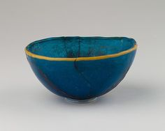 Bowl Period: New Kingdom, Ramesside Dynasty: Dynasty 19–20 Date: ca. 1295–1070 B.C. Geography: From Egypt Medium: Glass, blue with yellow rim band Dimensions: H. 5 cm (1 15/16 in); diam. 11 cm (4 5/16 in) Credit Line: Theodore M. Davis Collection, Bequest of Theodore M. Davis, 1915
