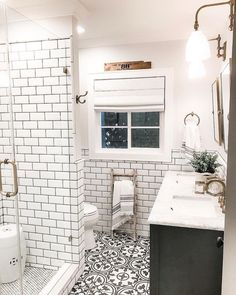 We think this bathroom is stunning! The white subway tiles with dark grout, & floor tiles coordinate beautifully with a splash of elevated style. Thx for including AFH homedecor here too! Modern Master Bathroom, Modern Farmhouse Bathroom, Small Bathroom, Antique Farmhouse, Downstairs Bathroom, White Bathrooms, Attic Bathroom, Beautiful Bathrooms, Bathroom Tile Designs