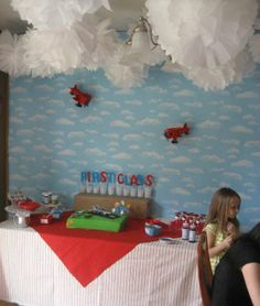 Tissue Paper pom-pom clouds... perfect way for me to incorporate them into a boy party ;)