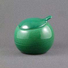 "Covered sugar bowl from the Town and Country dinnerware line in the Quartette glaze called Ming Green. Eva Zeisel designed this line for Red Wing in the 1940s.     The Quartette glaze is not Eva's but appears on Red Wing Town and Country serving pieces as a part of the ""Informal Supper Service"" line in 1951."