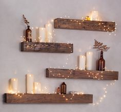 Turn a plain wall into a unique display with rustic shelves and easy, battery operated lighting. Shelves #39407;  Firefly String Lights #65C34;  LED Pillar Candles #58A39