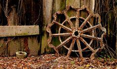 old wheel against a barn