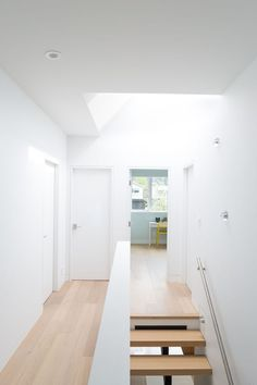 White walls and white oak floors provide a contemporary look in this home.