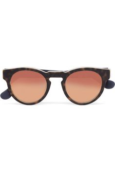 Part of the 'Rose Gold' collection, Westward Leaning x Olivia Palermo's 'Voyager' sunglasses are fitted with mirrored lenses. This round-frame pair is crafted from layers of matte tortoiseshell, white and black acetate. Hand-finished in San Francisco, this collaborative style is inlaid with bright marbled panels at the temples for a pop of color.