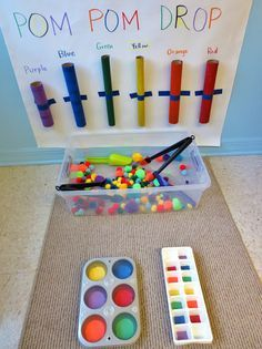 Abstract Invitation to Play: Pom-Pom Drop & Color Sorting Fun for Toddlers - would take a little preparation to collect and paint the tubes.
