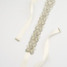 MADE TO ORDER - Please allow 3 - 5 business days to complete work.  1 pc vintage inspired rhinestone crystals dress belt. * Rhinestone applique measure : 2 W x 21 L * Finished with 7/8 double faced satin ribbon * Ribbon attachment is enhanced with a thin layer of white felt bedding * Ribbon measure : 3 or 4 yards (end to end) * Rhinestone pieces added at both ends and both sides * Ties ribbon bow in the back. Please choose ribbon color from drop down menu. There are more ribbon colors to...