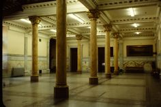 Marble columns line the interior view of the Old City Hall, Toronto, Ontario, Canada. Romanesque Revival.