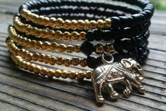 Hey, I found this really awesome Etsy listing at https://www.etsy.com/listing/287430485/black-and-gold-elephant-bracelet