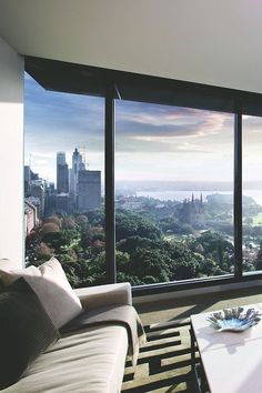 A beautiful living room with the most breathtaking view of New York City