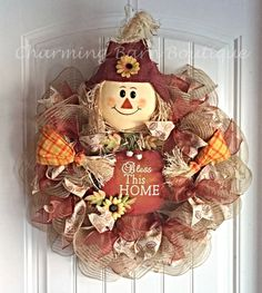 This adorable scarecrow wreath is just too cute and a must have addition for your fall decor. Scarecrow holding a Bless This Home metal