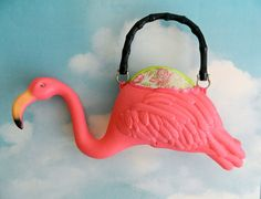 I would so carry this: Pink Flamingo Purse. $42.00, via Etsy.
