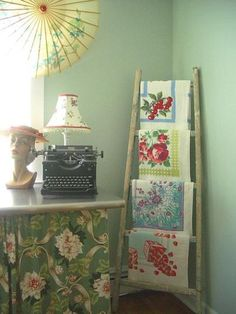 All kinds of awesome here!  Typewriter, linens and ladder.