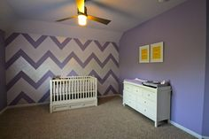 We love a good #chevron wall!  #nursery #purpleandwhite