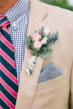 groom in gingham shirt with navy and pink striped tie and pink rosebud boutonniere