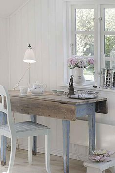 old table, nice blue patina...what a lovely little spot to create for yourself to have a cup of tea, open mail...think in peace