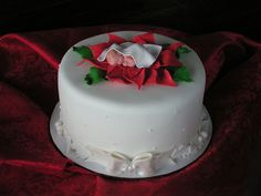 Fondant covered cake with fondant accents and gumpaste topper