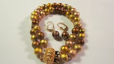 Gold double strand bracelet set with free pair of by yasmi65, $17.00