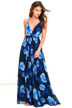 You'll feel like you're floating on a cloud in the Only in Dreams Navy Blue Floral Print Maxi Dress! Lovely navy blue chiffon in an allover rose print flows from spaghetti straps, into a surplice bodice, and strappy open back. Full maxi skirt flows from the elasticized waist.