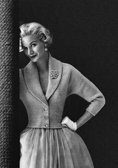 1950s Sunny Harnett in cropped, fitted knit jacket w/shawl collar and gathered skirt.