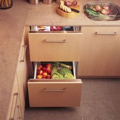 i love how refrigerator drawers can just be hidden right into the cabinetry