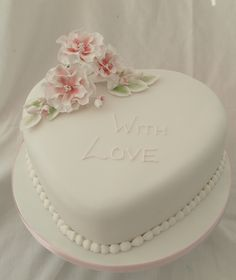 With love heart shaped cake with sugar ruffle roses