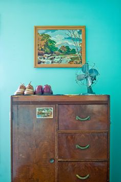 "Sneak Peek: Best of Turquoise. ""This worn-in, vintage armoire nicely offsets the boldness of Liz Cook's bedroom walls."" #sneakpeek #turquoise"