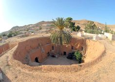 """The traditional underground homes are sometimes described as """"troglodyte"""" structures. They are found in Matmata, Tunisia. Tunisia Hotels, Where The Sun Rises, Casa Patio, Underground Cities, In Ancient Times, North Africa, Wonders Of The World, Around The Worlds, The Incredibles"""