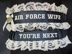 Air Force garter set with AIR FORCE WIFE embroidered on it on navy blue satin and throw garter that's says You're next