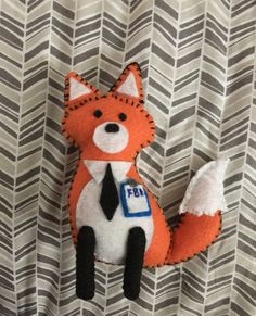 """…and if you want something a little more cuddly, there's this plush toy of FOX Mulder: 