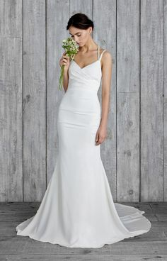Our Taylor gown is made from luxurious stretch silk with a faux-wrap bodice and hand-beaded crisscross straps, The back and side ruching is slimming and scul...