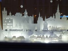Interactive christmas window display by Wellen, Prague visual merchandising. Love the city skyline!