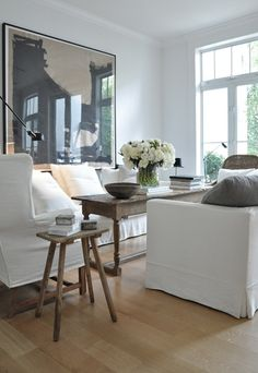 power of a solid pillow...and I like the little wooden stool as end table