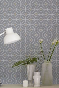 Laterza by Designers Guild is a stunning geometric wallpaper design with metallic centres.