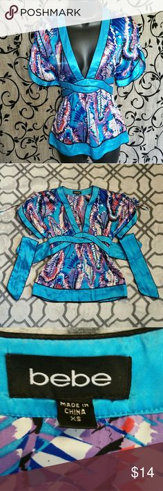 BEBE Silk V-Neck Tie Waist Blouse Good condition, turquoise/red/white/purple  geometric contrast, size XS bebe Tops Blouses