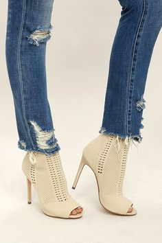 Show off your style like you mean it with the Steve Madden Candid Nude Knit High Heel Peep-Toe Booties! Sleek and stretchy pierced knit covers these peep-toe booties with a sturdy heel cup, and ankle-high shaft.