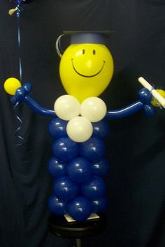 """Smiley Grad man in """"Balloon Creations and Deliveries"""" by Christine Swanson"""