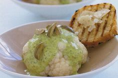 Baby cauliflowers with green olives and citrus vinaigrette