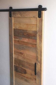 Barn Door Hardware  - RLP Flat Track, Black, Rectangular Hanger. 5 feet for 265$. That's actually way cheaper than most.