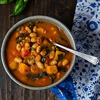 White Bean Stew with Winter Squash and Kale - yellow-eye or navy beans, onion, garlic cloves, water, smoked paprika, dried oregano, ground cumin, dried basil, winter squash or pumpkin, red bell pepper, jalapeño pepper (optional), canned diced tomatoes (fire-roasted preferred), salt, kale, corn (optional), fresh basil