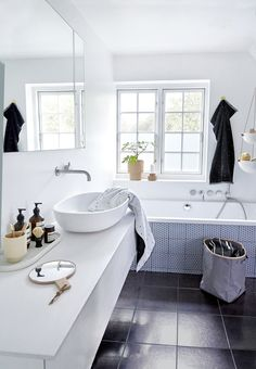 Bright and clean bathroom with interior design by OYOY.