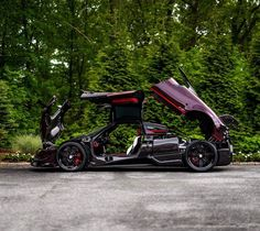 """Pagani Huayra BC """"Kingtasma"""" in Rad and Black carbon fiber w/ Red accents, Tricolore stripes & 24 Karat gold crowns under the rear aerodynamic flaps. Photo taken by: @jgucars on Instagram Owned by: @sparky18888 & @vtm_theking_4 on Instagram"""