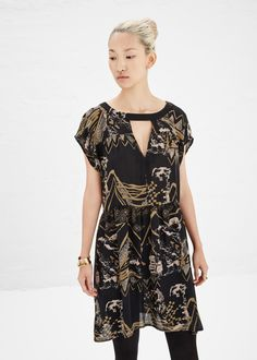 Short-sleeved dress in black silk with multicolored pattern throughout, keyhole opening at front collar and back, wide crewneck, and seam pockets. Slips on. Dry clean only.