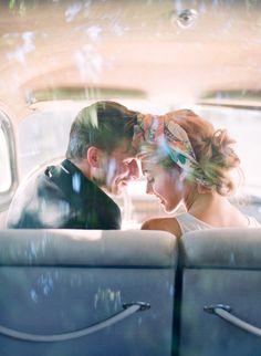 Adorable wedding photograph: bride + groom in the getaway car.