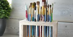 "I've got a super-simple build for you today;  this paint brush storage rack will take you a grand total of 20 minutes to build and will use up 4 pieces of scrap wood from your pile. Cut two pieces of wood - I used 3/4"" plywood - to 7"" by 4"". Cut two pieces of wood -"