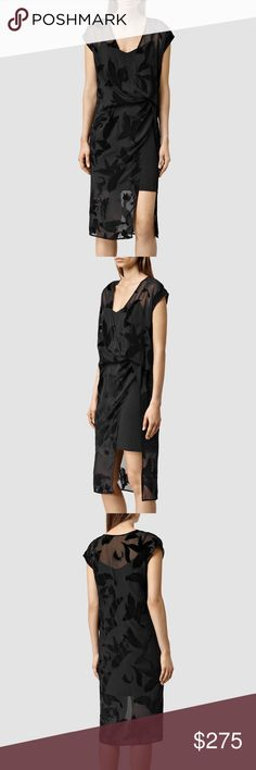 ALLSAINTS Kelso Lux Riviera Foral Mesh Slit Dress The Kelso Lux Dress by ALLSAINTS exudes femininity in a flattering silhouette. Utilising layers to chic effect, this beauty features a fitted under-layer with a lightweight and fluid top layer strewn with velvet leaves that fall elegantly over the figure. It features Slit detailing through the leg as well as a wrap neckline, demure midi length and capped sleeves easily take this dress from day to night! 89.5cm bust, 71.5cm waist, 96.5cm hips…