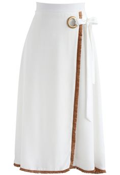 Go ahead and tie the knot with your skirt obsession and do this thing the right way! This flap skirt in a creamy white hue makes for the perfect item to slip into easily and look fab in this summer. Its brown fringy hemline pulls away from serious tones and makes it a playful garment for the season.  - Self-tie bowknot on waist - Tassel trimming - Concealed back zip closure - Lined - 100% polyester - Hand wash cold  Size(cm)Length Waist   S                  75       66 M                 75  …