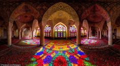 As the sun shines through the stained glass windows, its dominant red hue is highlighted by a kailedoscope of colours