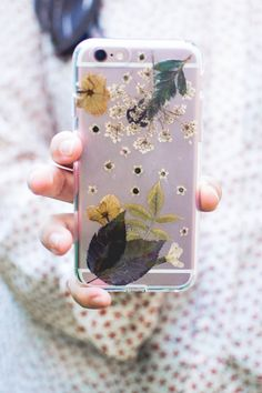 Make this pressed flower phone case with gorgeous plants, flowers, and herbs that you collect! It's a simple way to keep nature at your fingertips.